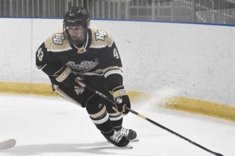 Tristyn Cox slices through the ice on Honeybaked hockey team