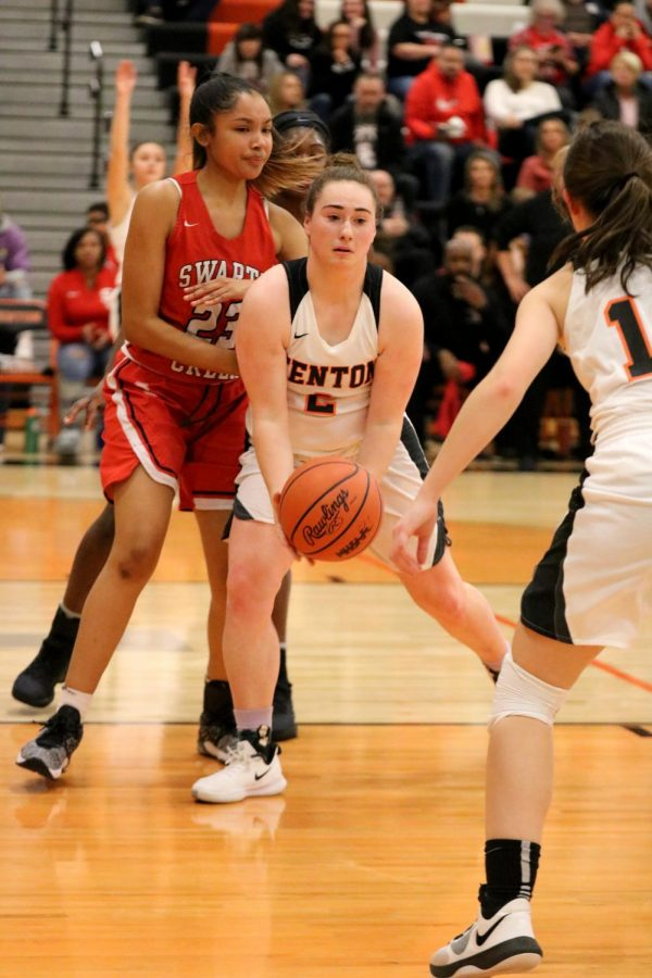 After dribbling down the court, senior Sam Whaling prepares to pass the ball off to a teammate. The girls varsity basketball team played the Swartz Creek Dragons on Jan. 31.