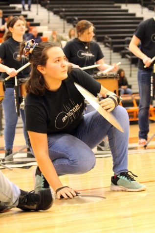 During halftime for the varsity boys basketball game, sophomore Samantha Megdanoff plays the cymbals in the drumline. On Feb. 28, the drumline and dance team put on a show during halftime.