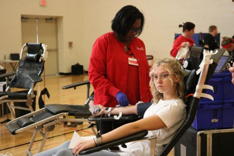 Senior Jaidyn Rodgers gets set up to get her blood drawn. On Mar. 9, a blood drive was held in Fenton's auxiliary gym.