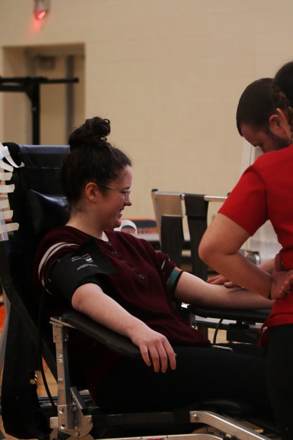 Senior Alyssa Keoshian gets her blood drawn on. The high school hosted a blood drive for the community on Mar. 9.