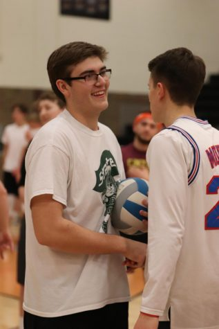 After playing their match in the Powder Tuff tournament, senior Bradley Trecha shakes hands with senior Jacob Boulay. The Fenton High hosted the Powder Tuff tournament on Feb. 24 where the seniors beat the juniors in the championship game.