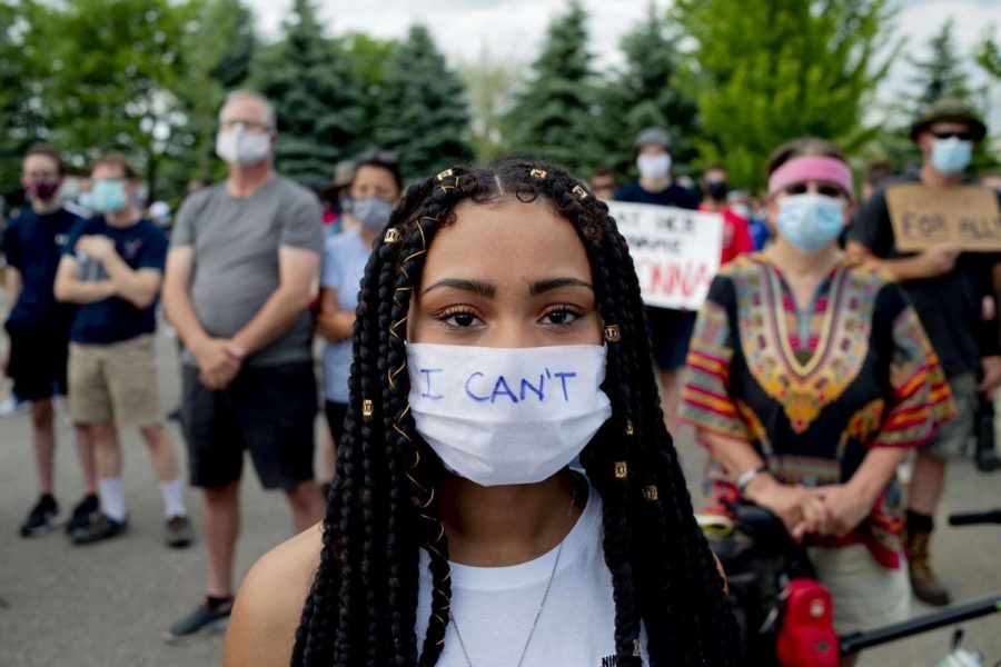 "Junior Alexis Walker stares down the camera at the June 6 Grand Blanc Black Lives Matter Protest. ""One thing that struck me was a little girl that led us in a chant during our march. She reminded me why we are fighting, which is for her future and for our future."""