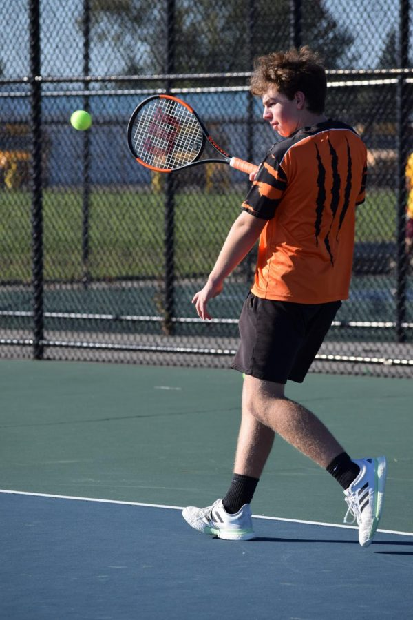 Sophomore Josh Brott is about to attempt to return the serve from the opposing team member by hitting a forehand at the Fenton High School tennis courts. Fenton played against Davison on October 5th.