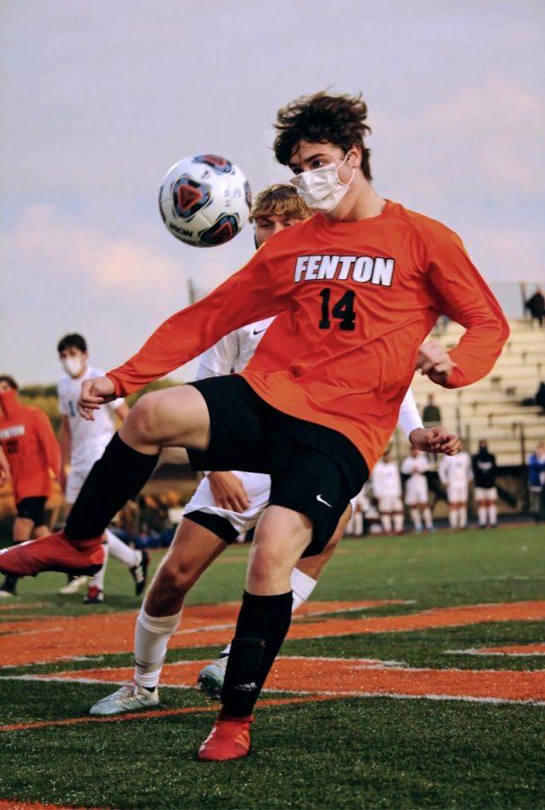 Eyes on the ball, senior Ashton McKellar kicks the ball to a teammate. FHS defeated Lake Fenton 6-1 on Sept. 28.