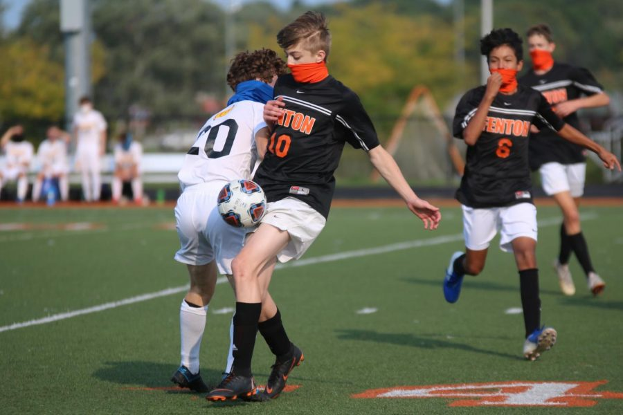 Sophomore Benjamin Grob helps to get a turnover for his team. On Sept. 16, the Tigers came out with the win with a score of 3-0.