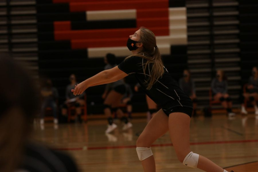 Sophomore Sienna Sahr attempting to pass the ball up to setter during the JV team