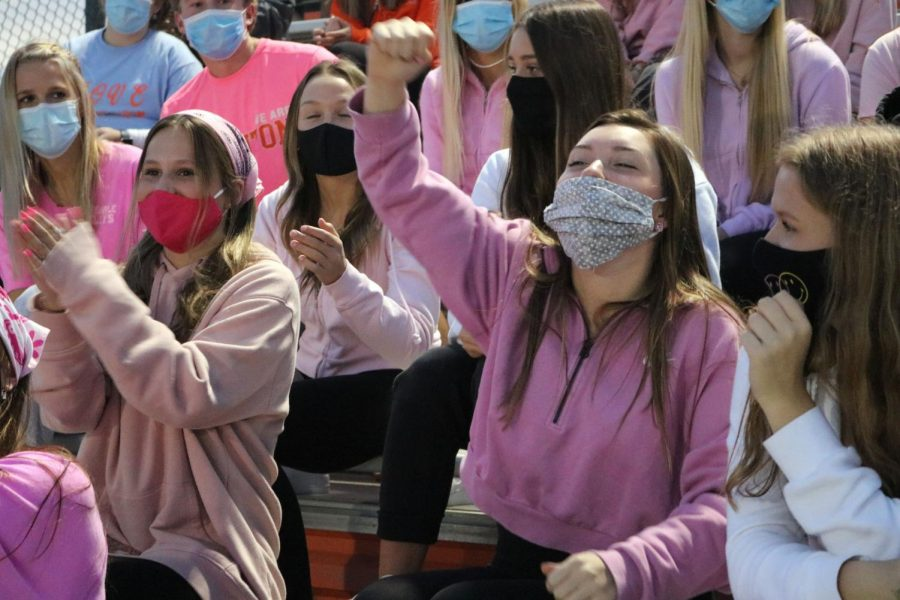 Senior Lydia Anderson cheers on the varsity soccer team with her classmates at the pink out game. On Oct. 9, the tigers played Powers at home winning 2-0.