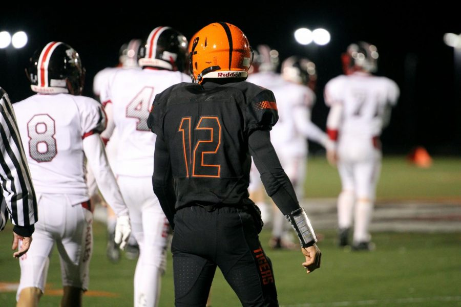 Sophomore Mason Canterbury, walks out to the field after reconnecting with his team. Fenton Highs JV team played Linden on Oct. 10, the score was 0-18 Linden.