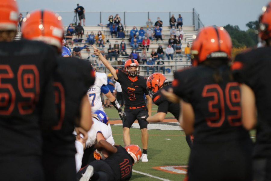 Junior Seth Logan helps the varsity football team to victory on Sept. 25. The Tigers won this game 50-14.