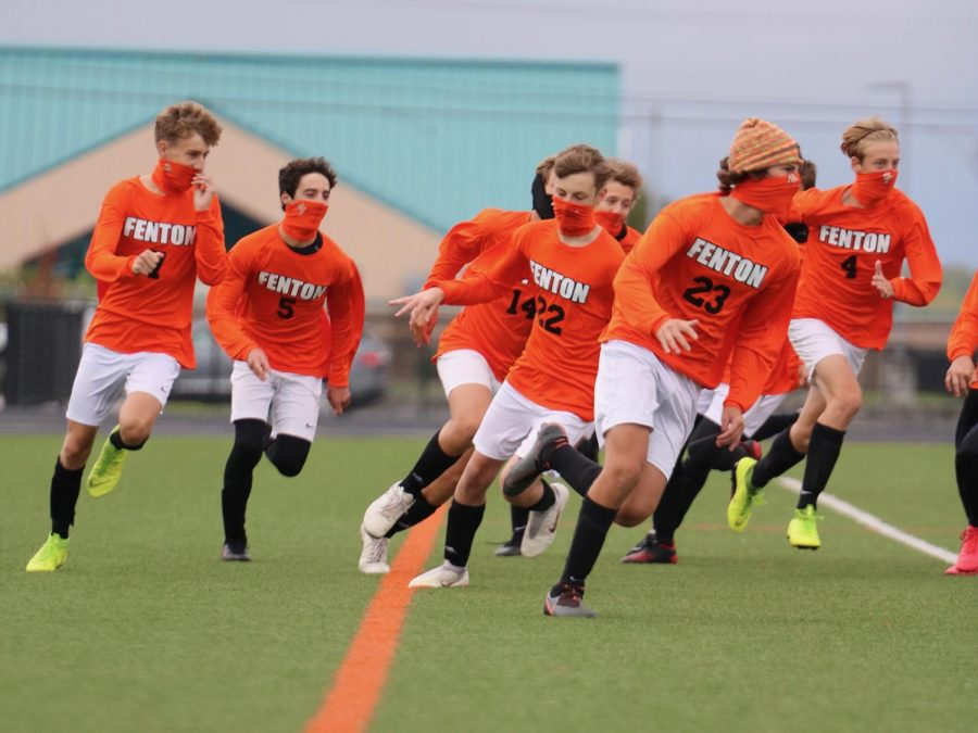As the JV soccer team warms up for the game on Sept. 30, they do their final run before the game begins. The Tigers won this game against Goodrich.