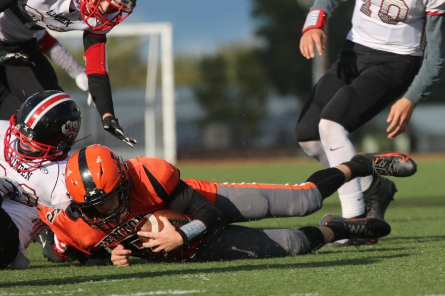 Jake Nichols, Freshman gets taken down by Linden Oct. 1. The freshman football team pulled through with a close game 22-20.