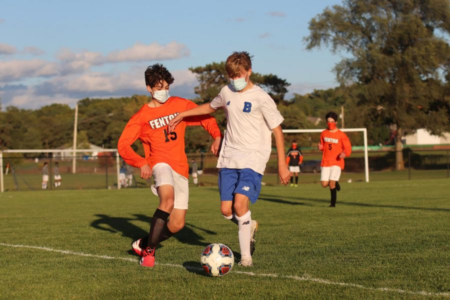 Freshman Nicholas Danley attempts to steal the ball from a Brandon player. The Tigers won 7-0 on Oct. 7 while hosting parent night.