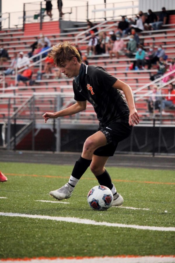 Senior Jimmy Myers focuses on passing to an opponent. On Sept. 16, the Tigers beat the Clio Mustangs 7-0.
