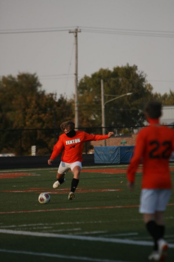 Sophomore Sam Snedden kicks the ball up the field to prevent the other team from scoring a goal. On Oct. 10, the Fenton boys JV team beat Powers 3-0.