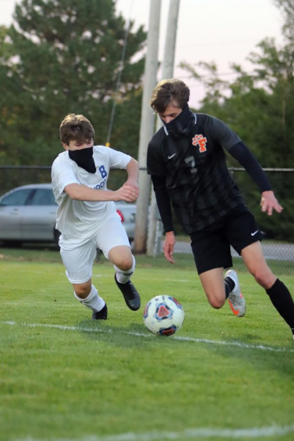 Junior Ben Chapple prepares to kick the ball to his teammate near the net. On Oct. 7, the Tigers played Ortonville Brandon at home, winning 3-1.