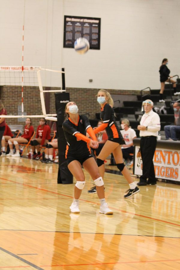 Senior goes to pass the volleyball in the first half of the game. Fenton faces Holly on Sept. 14.