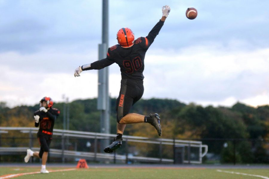 Sophomore Zach Kramer jumps for the ball in warm ups before their big game against Kearsley. The Fenton JV team lost 14-50 on Oct. 1.