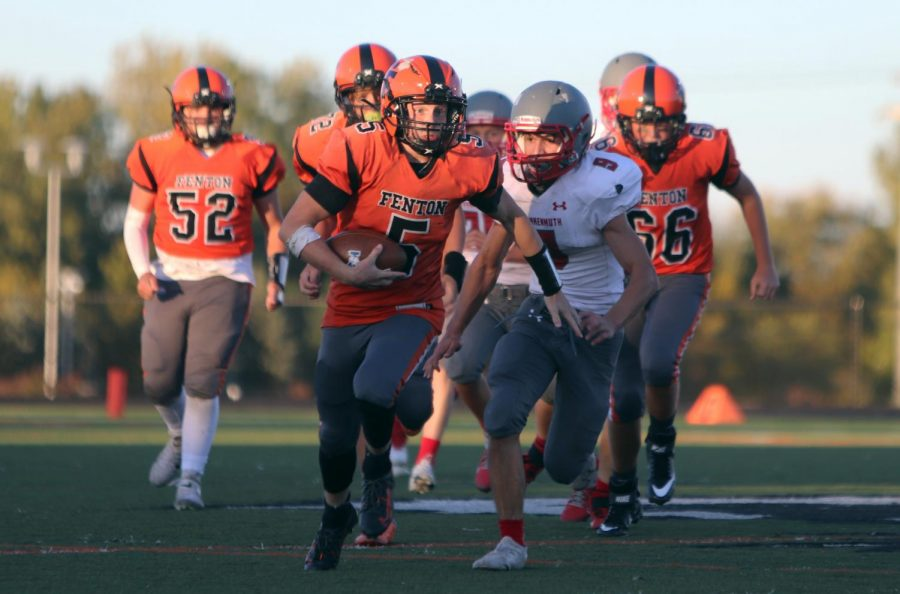 Freshman Jake Nichols runs the ball down the field on Oct. 8. Fentons freshman football lost this game against frankenmuth  20-36.