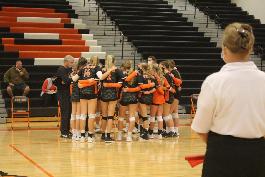 Fenton varsity volleyball team huddles up to discuss their next moves going forward in the game. Fenton went against Swartz Creek on Oct. 7.