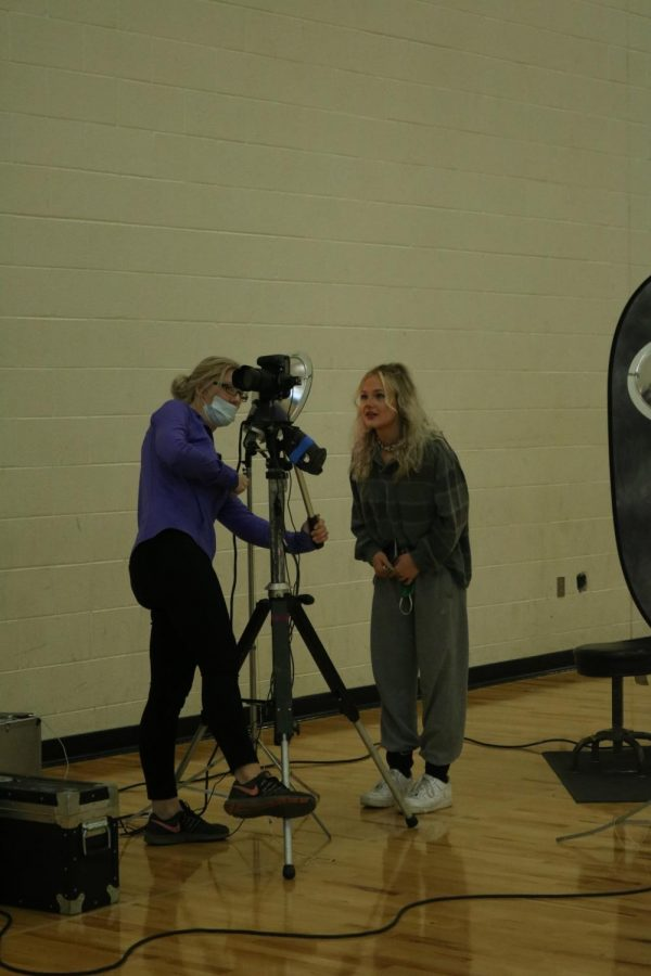 Junior Brianna Foguth looks at the picture the photographer took of her. On Nov. 11 Fenton had picture retake day.