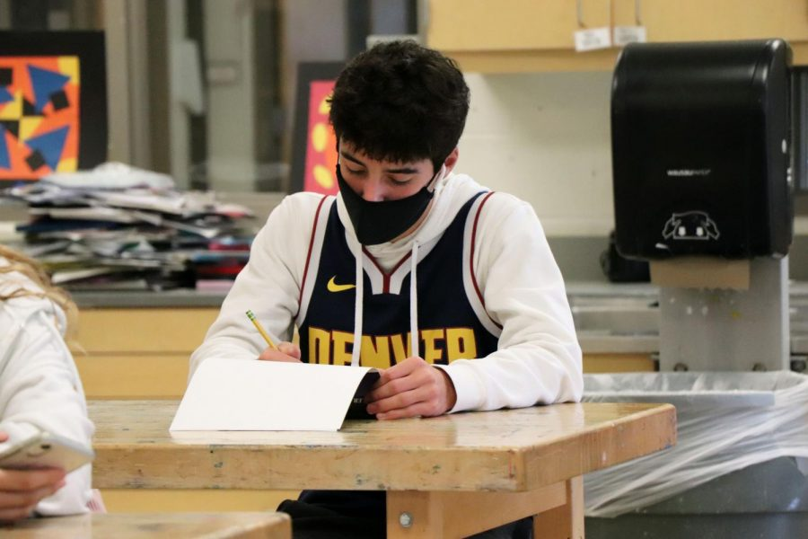Sophomore Ryan Stocker is working on his art project. Art Foundations 1 is currently working on their art techniques for ink pens, this was taken on 11-2.