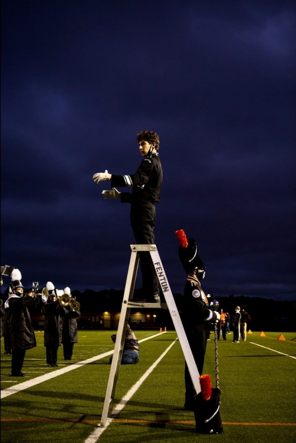 """If I hear the phrase 'be yourself,' marching band instantly comes to mind, because to me, 'being yourself' means expressing yourself and being passionately immersed in something you love. For the last two years, I've had the honor of drum majoring on behalf of Fenton's marching band, and nothing has made me feel more alive. Enveloped in music is where I feel most at home, and most truly myself. I'm extremely grateful for the experiences I've had with the marching band, and am excited that the ensemble provides those same experiences for future generations of musicians."" - senior Brody Stack"