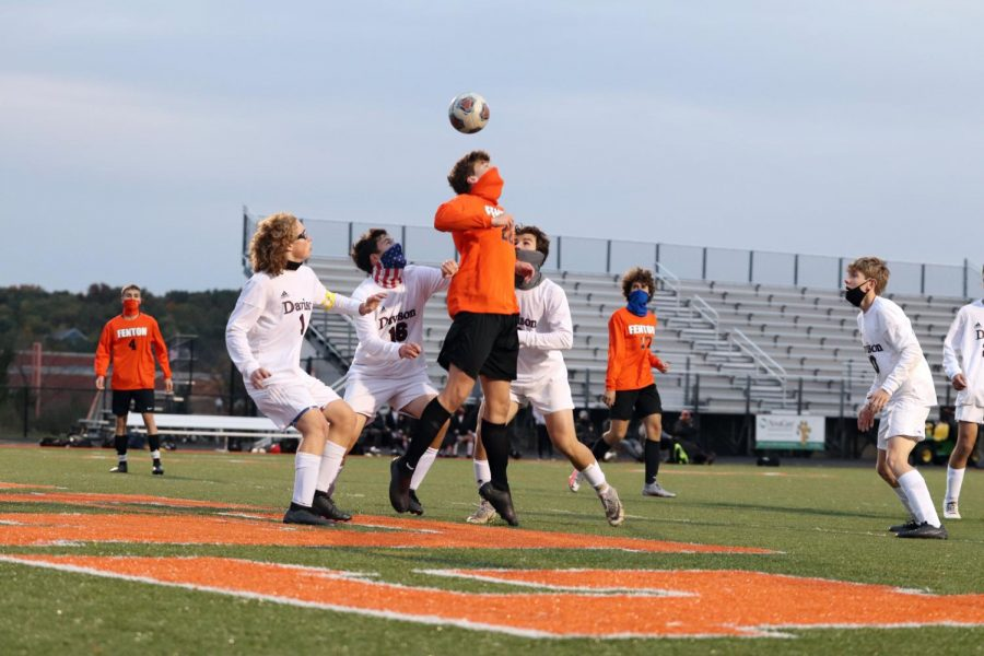 Senior Zander Fulton bounces the ball off of his head in a game against Davison right before the Tigers make another goal. The game was won 5-0 on Oct. 14th.