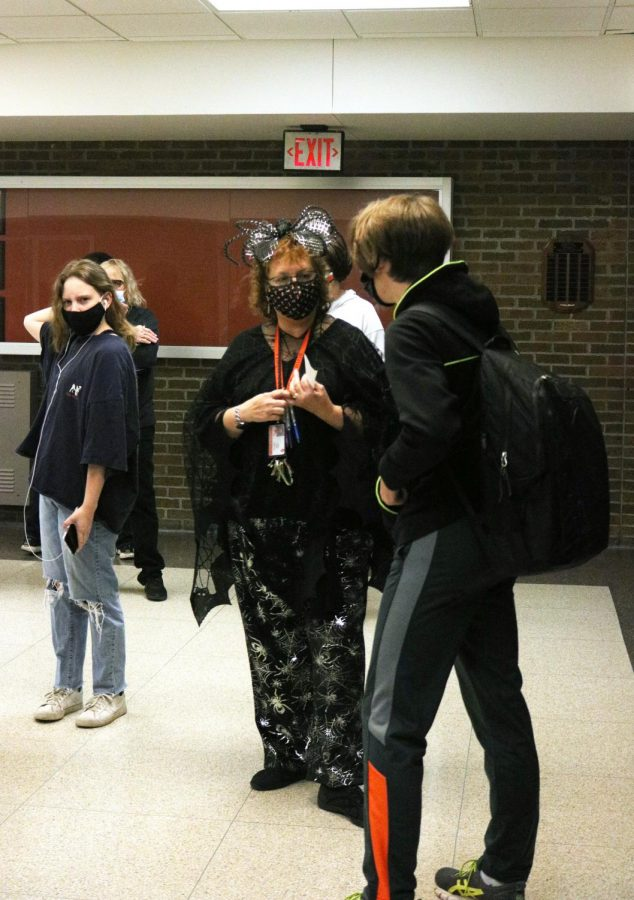 Mrs. Lemke talks to a student in the hallways as she dresses up in black scary clothes for our black and orange spirit day at FHS on Oct. 30.