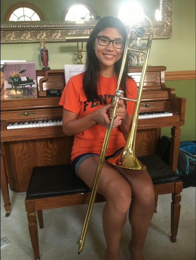 """""""I took piano lessons in elementary school and I've been playing the trombone since sixth grade. Recently I have been trying to improve my skills on the piano because I haven't played for a while. I've mostly been focusing on the trombone so that I can do well in marching band and concert band. Band camp this summer was really fun and I'm looking forward to performing at the football games."""" - freshman Catherine Borg"""