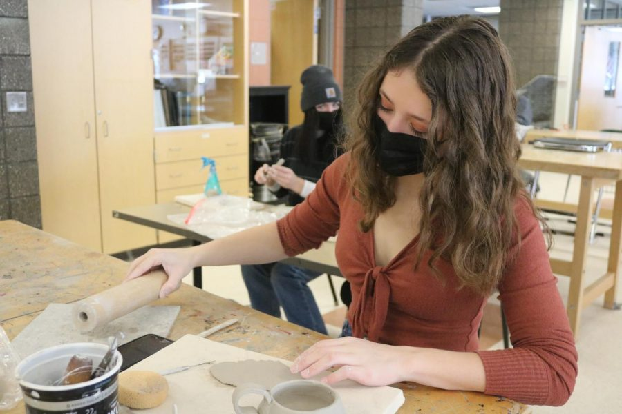 Rolling out clay, senior Hannah Ludwig makes her art project. On Feb. 24, students in Tracy Jambeck's 2nd hour AP art class made art out of clay.