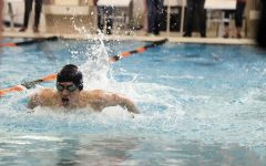 Sophomore Max Haney competes against Grand Blanc and Pinckney on Feb 9.