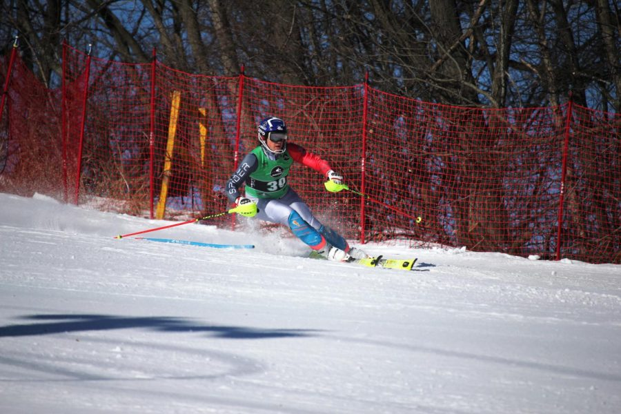 Eyes on the next gate, sophomore Ryland Fairbanks makes his way through the slalom course. On Feb. 25, the varsity Alpine ski team competed at the South Eastern Michigan Ski League Championship after qualifying at Regionals.