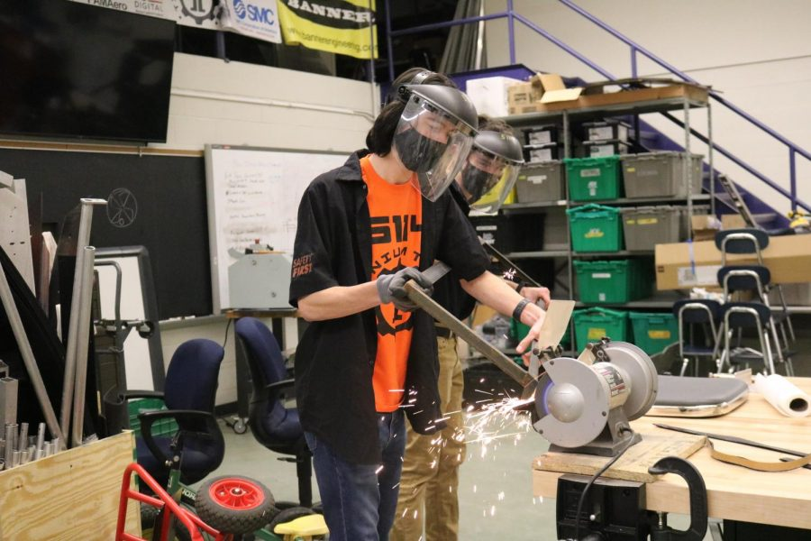 With+sparks+flying%2C+seniors+Shawn+Defina+and+Brody+Stack+grind+down+a+piece+of+steel.+The+Fenton+Robotics+team+meets+every+Tuesday+and+Thursday.+
