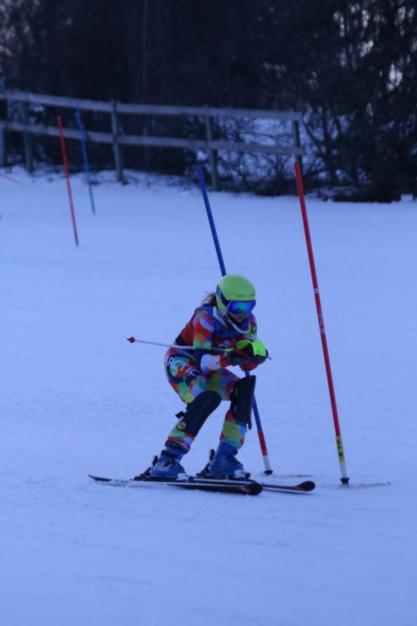 Passing a gate, senior Lydia Anderson approaches the finish. On Jan 13 the Alpine Ski Team raced at Mt. Holly.