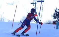 Making his way down the hill, sophomore Joshua Brott approaches a gate. On Jan 27 the Alpine Ski Team raced at Mt. Holly.
