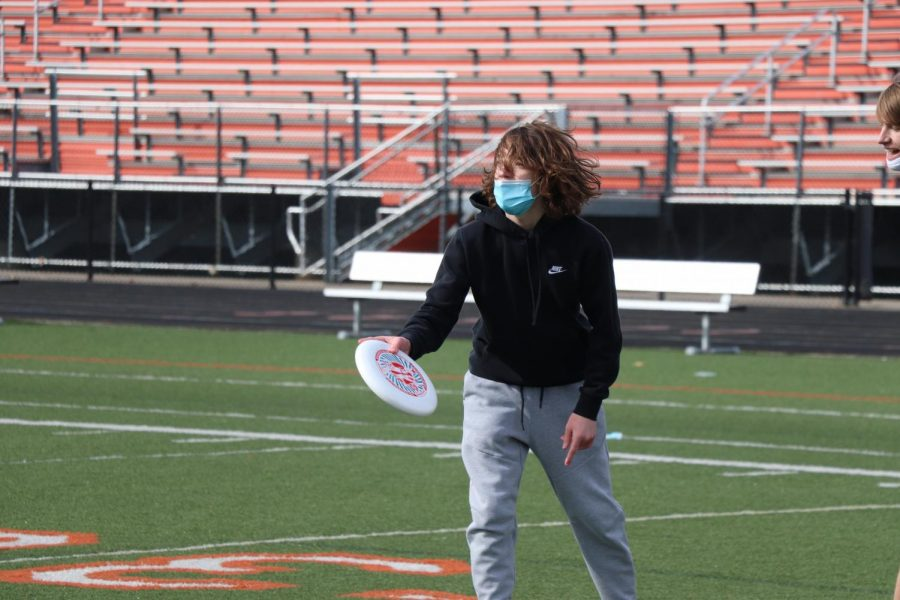 Freshman Nathan Finch is scoping out the field to find an open teammate to throw the frisbee to during gym class.