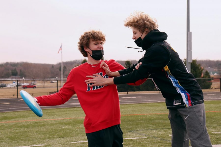 Freshmen Spencer Luck and Jack Coleman go head-to-head in a game of ultimate frisbee. On Mar. 23, Mrs. Moore took her gym students out to the field to enjoy the nice weather.