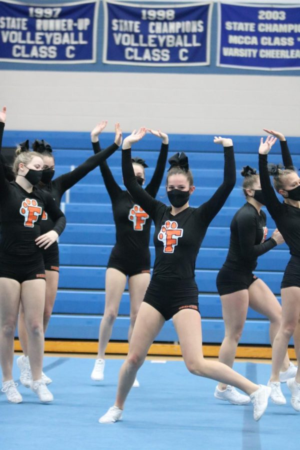 The Fenton Tigers approach the mat for the cheer meet on 2/26. The tigers took 1st.