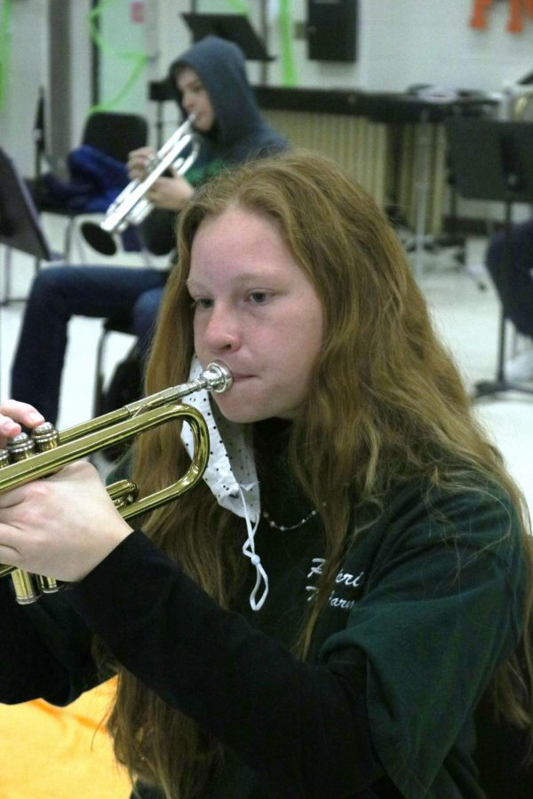 Freshman Nina Frost plays her trumpet during band class.