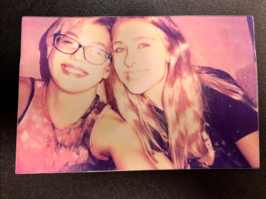 """""""My polaroid camera is important to me because it keeps snapshots of my favorite times with friends and family. I can put the photos on my wall and surround myself with good memories."""" - sophomore Samirrah Dodge (left)"""