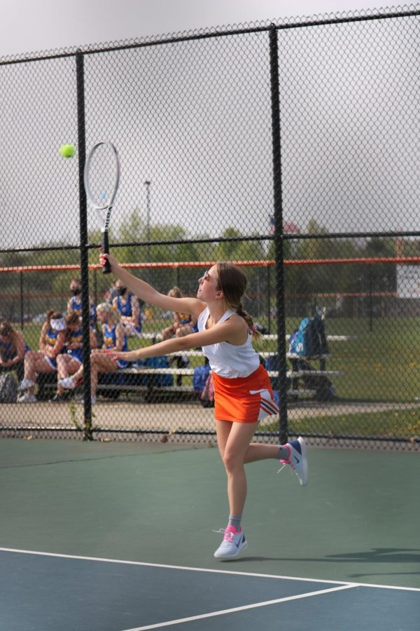 Junior Kiersten Lapa serves the tennis ball to the opposing team. On April 27, the varsity girls tennis team played Kearsley at home.