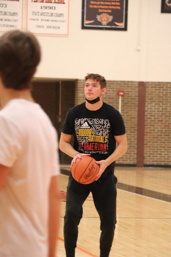 Senior Brandon Miller prepares to shoot the basketball into the hoop. On April 19, the 2nd hour gym class played basketball.