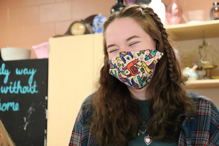 Senior Samantha Terrian smiles under her mask. On April 27, the spirit day was mask day, where students wore masks with different colors and patterns.