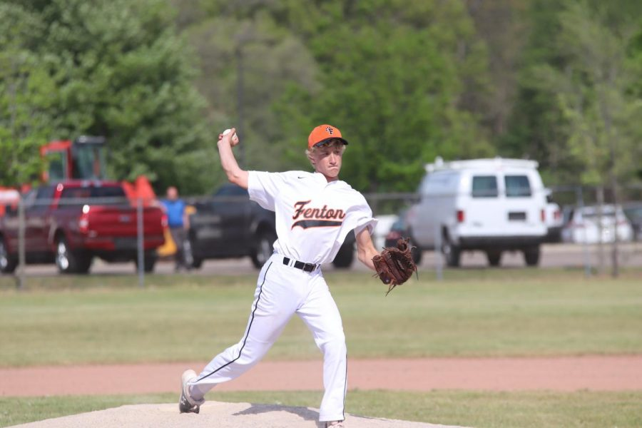 Freshman Philip Yurke pitches against the Grand Blanc Bobcats ingame on 5/21.