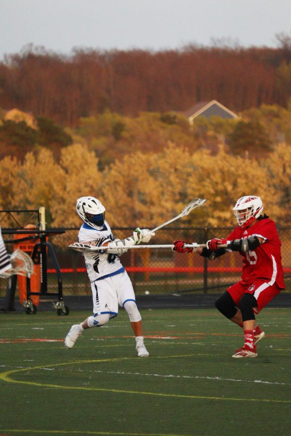 Senior Chase Everhard goes in for a goal against a Swartz Creek opponent. On Apr. 26, the Tigers __ the Dragons ____.