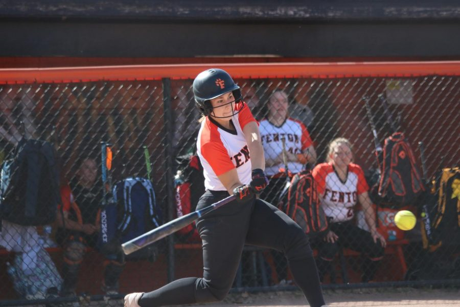 Sophomore Maddie Burnau hits a homerun against Flushing on 5/13.