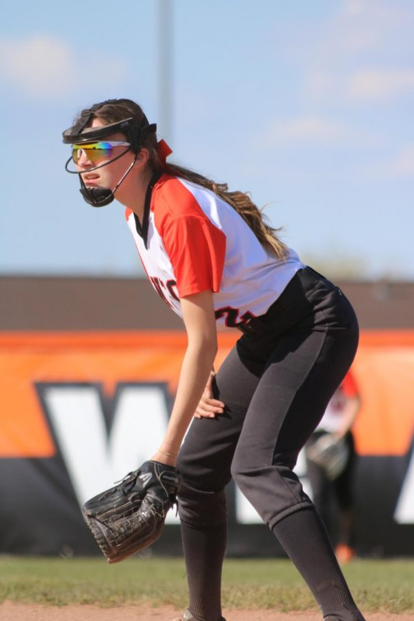 Junior Kailey Bombe is in the outfield preparing to catch a ball hit by Flushing on 5/13.