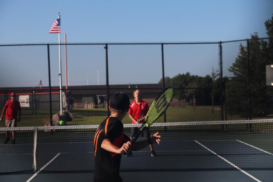 Sophomore+Ian+Mills+prepares+to+return+the+tennis+ball+to+the+opposing+JV+Holly+duo.+sophomore+Ian+Mills+and+his+partner+Landon+Nguyen+lost+the+match+0-6+to+2-6++against+the+pair+from+Holly+on+September+2nd.