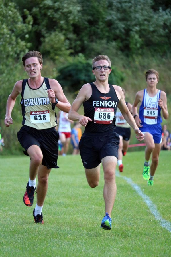 Racing for the next spot, senior Evan Koch pulls ahead. On Sept. 8, Fenton came out on top winning the first jamboree of this season at Linden middle school.
